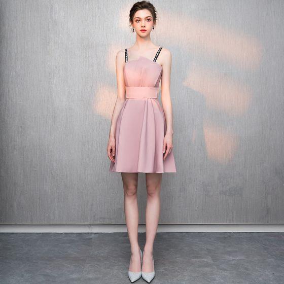 89345853a68e modest-simple-blushing-pink-homecoming-graduation-dresses-2018-a-line- princess-backless-spaghetti-straps-sleeveless-short-prom-dresses-560x560.jpg