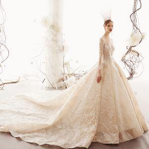 Glamourös Champagner Durchsichtige Brautkleider / Hochzeitskleider 2019 Prinzessin Rundhalsausschnitt Lange Ärmel Handgefertigt Perlenstickerei Glanz Tülle Kathedrale Schleppe