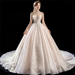 Luxury / Gorgeous Champagne See-through Wedding Dresses 2018 Ball Gown High Neck Short Sleeve Backless Appliques Lace Beading Tassel Glitter Tulle Royal Train Ruffle