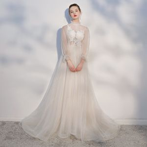Elegant Champagne Beach Wedding Dresses 2018 A-Line / Princess Lace Appliques Scoop Neck Backless Long Sleeve Chapel Train Wedding