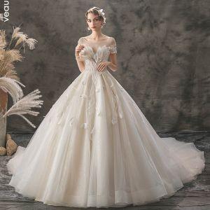 Romantique Champagne Transparentes Robe De Mariée 2019 Princesse Encolure Carrée Manches Courtes Dos Nu Appliques En Dentelle Perlage Glitter Tulle Cathedral Train Volants