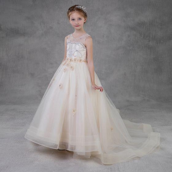 Eleganckie Szampan Przezroczyste Sukienki Dla Dziewczynek 2018 Princessa Wycięciem Bez Rękawów Aplikacje Kwiat Perła Rhinestone Trenem Sąd Wzburzyć Sukienki Na Wesele