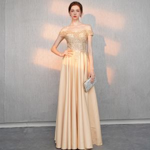 Elegant Gold Evening Dresses  2018 A-Line / Princess Off-The-Shoulder Short Sleeve Beading Floor-Length / Long Ruffle Backless Formal Dresses