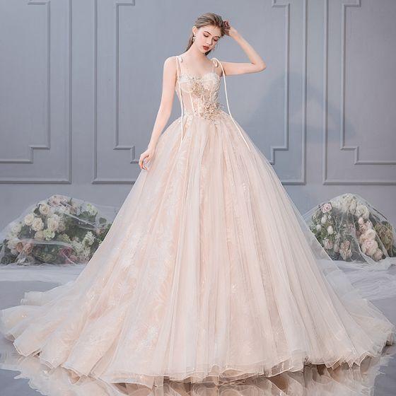 a91f8099ee3c elegant-champagne-wedding-dresses-2019-ball-gown-spaghetti-straps -bow-beading-rhinestone-pearl-lace-flower-appliques-sleeveless-backless-royal-train-560x560.jpg