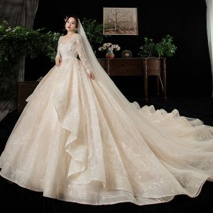Chic / Beautiful Champagne Plus Size Wedding Dresses 2020 Ball Gown V-Neck Long Sleeve Backless Appliques Lace Beading Cathedral Train Ruffle