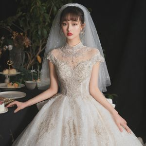 Luxury / Gorgeous Champagne Bridal Wedding Dresses 2020 Ball Gown See-through High Neck Short Sleeve Appliques Lace Beading Sequins Cathedral Train Ruffle