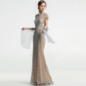 Luxus / Herrlich Champagner Durchsichtige Abendkleider 2019 Meerjungfrau Rundhalsausschnitt Kurze Ärmel Handgefertigt Perlenstickerei Sweep / Pinsel Zug Festliche Kleider