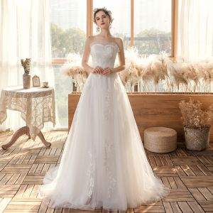 Affordable White Outdoor / Garden Wedding Dresses 2020 A-Line / Princess Sweetheart Sleeveless Backless Appliques Lace Sweep Train Ruffle