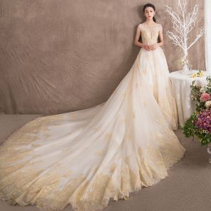 Luxury / Gorgeous Ivory See-through Wedding Dresses 2018 A-Line / Princess Scoop Neck Sleeveless Backless Gold Appliques Lace Ruffle Royal Train