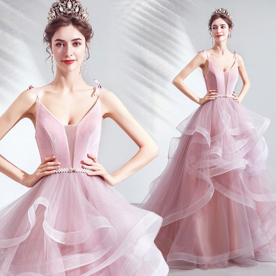 Stunning Blushing Pink Princess Prom Dresses 2021 Spaghetti Straps Deep V-Neck Sleeveless Pearl Bow Sash Backless Ruffle Court Train Formal Dresses