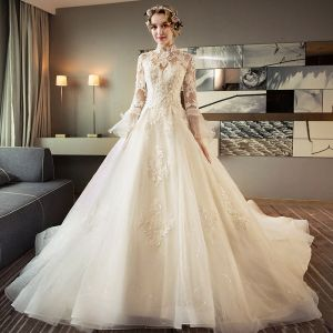 Chinese style Ivory Pierced Wedding Dresses 2018 Ball Gown High Neck Long Sleeve Backless Appliques Lace Beading Glitter Tulle Ruffle Royal Train