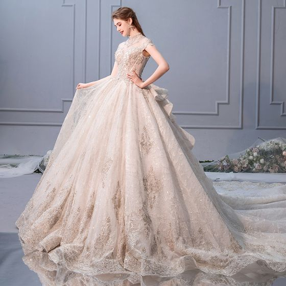 luxury-gorgeous-champagne-wedding-dresses-2019-ball-gown-scoop-neck-beading-pearl-sequins-lace-flower-cap-sleeves-backless-royal-train-cascading-ruffles-560x560.jpg