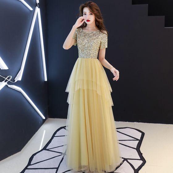 f03b9b43b8 Niedrogie Złote Cekiny Sukienki Wieczorowe 2019 Princessa Wycięciem Kótkie Rękawy  Długie Kaskadowe Falbany Sukienki Wizytowe
