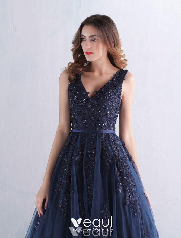 V ringad klänning marinblå
