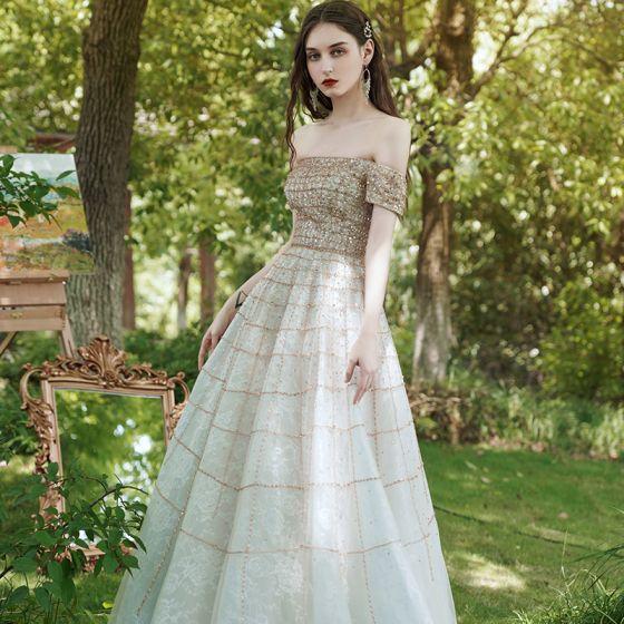 Mejor Oro Vestidos de gala 2020 Ball Gown Fuera Del Hombro Manga Corta Rhinestone Rebordear Largos Ruffle Sin Espalda Vestidos Formales