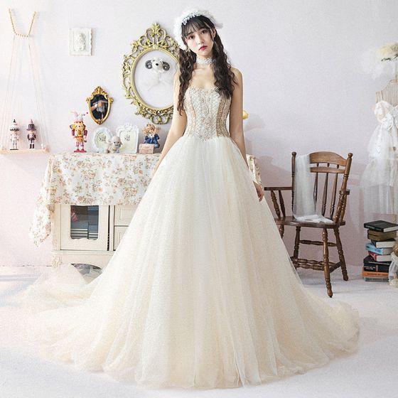 8e89b38f07 modern-fashion-champagne-wedding-dresses-2019-ball-gown-sweetheart -detachable-puffy-short-sleeve-backless-pearl-beading -cathedral-train-ruffle-560x560.jpg