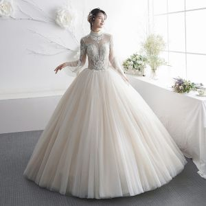 Illusion Champagne See-through Wedding Dresses 2019 A-Line / Princess High Neck Bell sleeves Backless Appliques Lace Beading Floor-Length / Long Ruffle