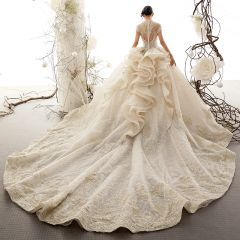 Luxury / Gorgeous Vintage / Retro Champagne See-through Wedding Dresses 2019 Ball Gown High Neck Short Sleeve Appliques Lace Glitter Tulle Cathedral Train Ruffle