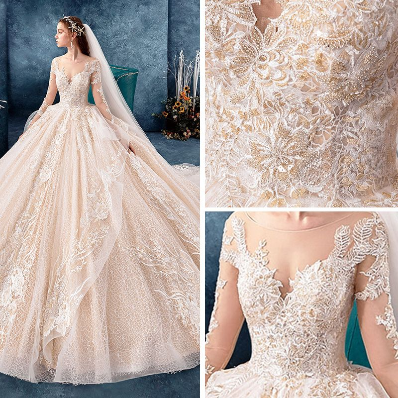 Romantic Champagne See-through Wedding Dresses 2019 Ball Gown Scoop Neck Long Sleeve Backless Appliques Lace Beading Cathedral Train Ruffle