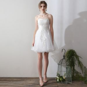 Affordable White Crossed Straps Wedding Dresses 2018 A-Line / Princess Tulle Sequins Strapless Wedding