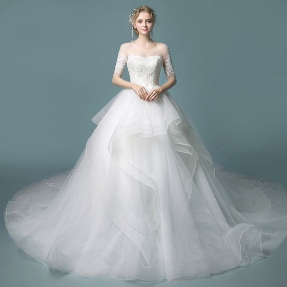 b73ef92b24 Affordable Ivory See-through Wedding Dresses 2019 Ball Gown Scoop Neck 1 2 Sleeves  Backless Appliques Lace Chapel Train Cascading Ruffles