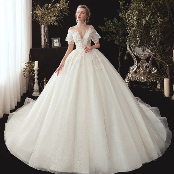 Victorian Style Champagne See-through Wedding Dresses 2020 Ball Gown V-Neck Puffy Short Sleeve Backless Glitter Tulle Appliques Lace Beading Chapel Train Ruffle