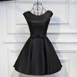 Encantador Negro Vestidos Formales 2017 Bowknot Sin Espalda Scoop Escote Cortos Ball Gown Vestidos de graduación