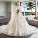 Luxus / Herrlich Champagner Brautkleider / Hochzeitskleider 2018 Ballkleid Perlenstickerei Pailletten Eckiger Ausschnitt Lange Ärmel Rückenfreies Königliche Schleppe