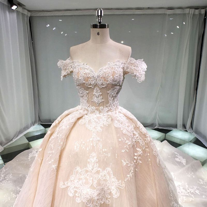 Stunning Champagne Wedding Dresses 2019 Princess Off-The-Shoulder Short Sleeve Backless Appliques Lace Beading Glitter Tulle Cathedral Train Ruffle