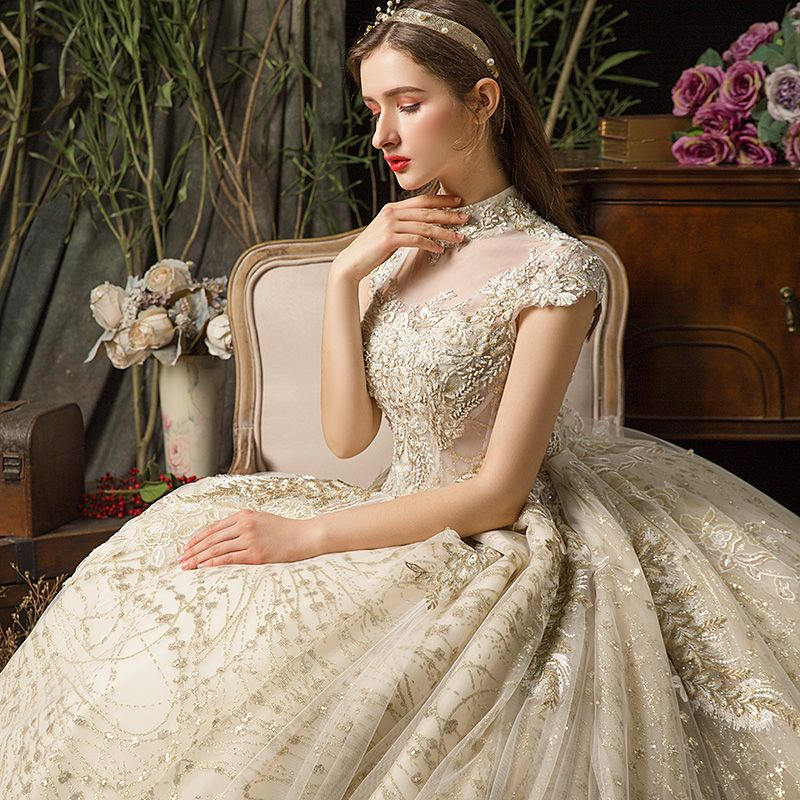 Vintage / Retro Champagne See-through Wedding Dresses 2019 Ball Gown High Neck Cap Sleeves Backless Appliques Lace Beading Rhinestone Cathedral Train Ruffle