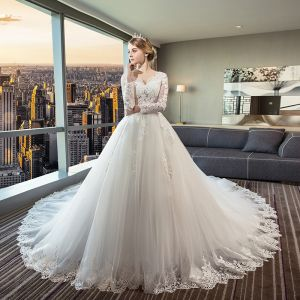 Chic / Beautiful Ivory See-through Wedding Dresses 2018 Ball Gown V-Neck Long Sleeve Backless Appliques Lace Ruffle Royal Train
