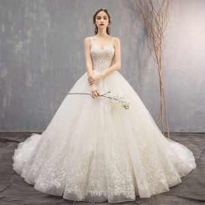 Best Ivory Wedding Dresses 2019 Ball Gown Spaghetti Straps Sleeveless Backless Appliques Lace Beading Chapel Train Ruffle