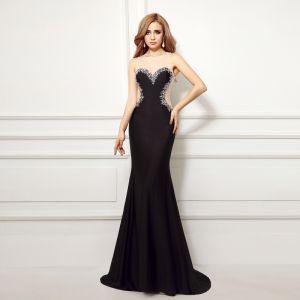 6ecd5c2d57 Seksowne Czarne Sukienki Wieczorowe 2017 Syrena   Rozkloszowane Wycięciem  Bez Rękawów Aplikacje Z Koronki Perła Trenem