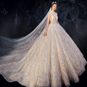 Sparkly Champagne See-through Wedding Dresses 2019 Ball Gown High Neck Cap Sleeves Backless Glitter Sequins Tulle Beading Royal Train Ruffle
