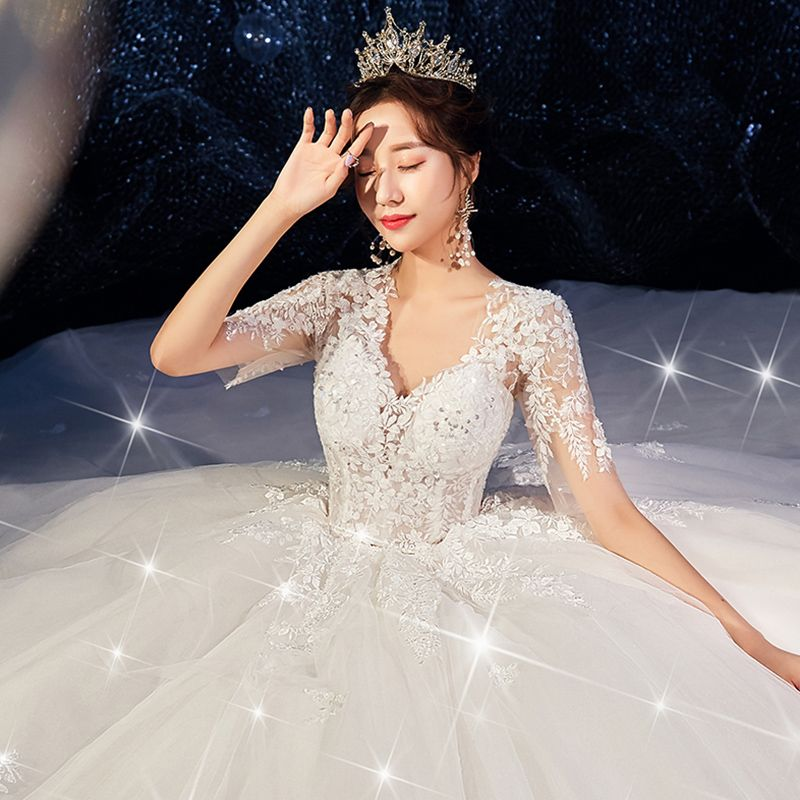 Romantic Champagne Wedding Dresses 2019 Ball Gown Deep V-Neck Short Sleeve Backless Pierced Appliques Lace Beading Cathedral Train Ruffle