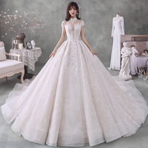 Vintage / Retro Champagne See-through Bridal Wedding Dresses 2020 Ball Gown High Neck Short Sleeve Backless Appliques Lace Beading Sequins Cathedral Train Ruffle