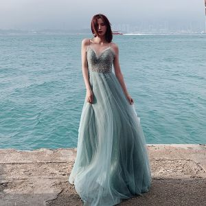 Eleganta Sexig Ocean Blå Aftonklänningar 2019 Prinsessa Spaghettiband Ärmlös Rhinestone Långa Ruffle Halterneck Formella Klänningar