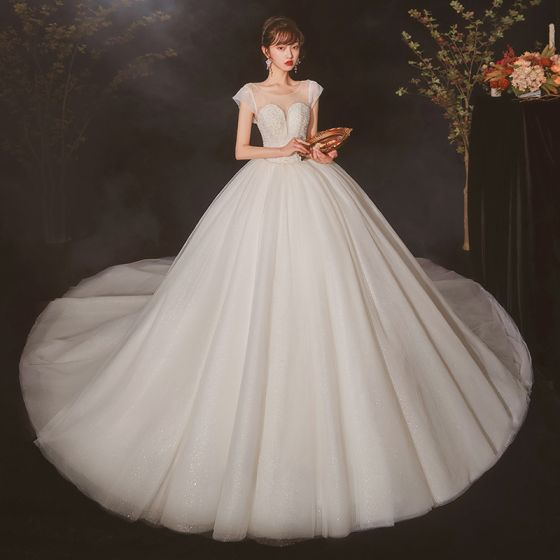 High-end Ivory See-through Bridal Wedding Dresses 2020 Ball Gown Scoop Neck Short Sleeve Backless Beading Glitter Tulle Cathedral Train Ruffle
