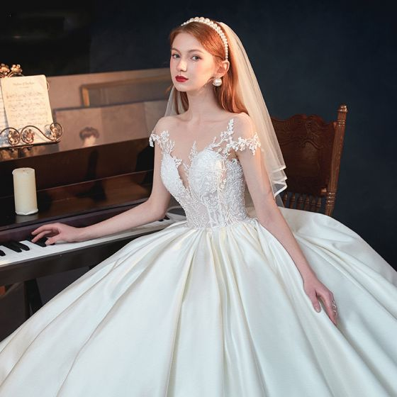 Illusion Ivory Satin See-through Bridal Wedding Dresses 2020 Ball Gown Scoop Neck Short Sleeve Backless Appliques Lace Beading Chapel Train Ruffle