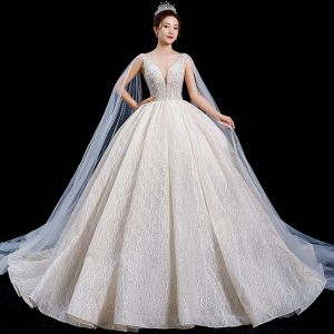 High-end Champagne Wedding Dresses 2020 Ball Gown Deep V-Neck Sleeveless Backless Appliques Lace Sequins Beading Watteau Train Ruffle