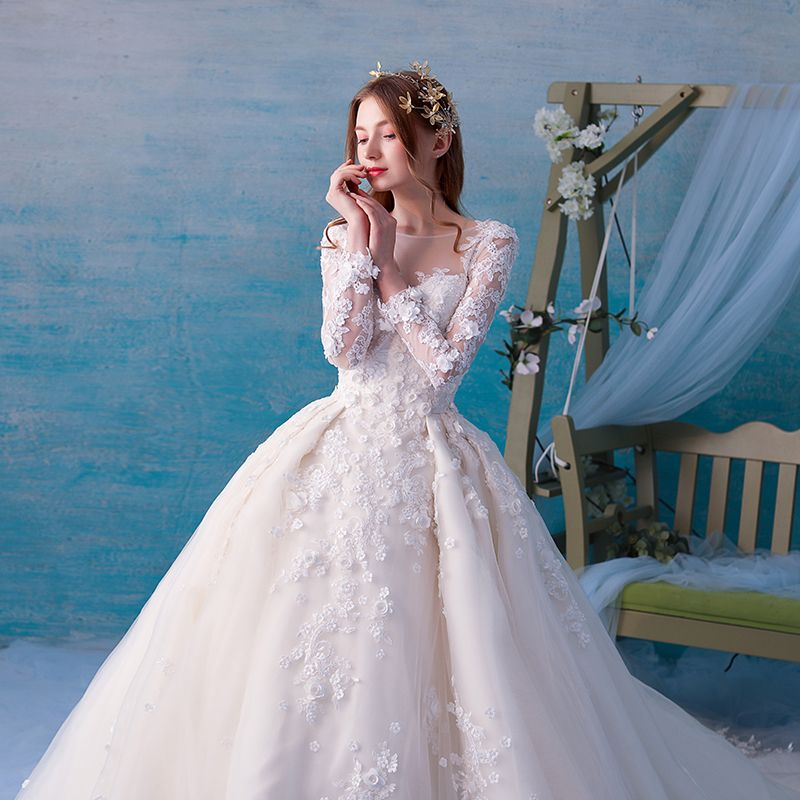 Chic / Beautiful Ivory See-through Wedding Dresses 2019 Ball Gown Scoop Neck Long Sleeve Backless Appliques Lace Pearl Cathedral Train Ruffle