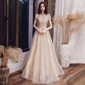 Vintage / Retro Champagne Evening Dresses  2020 A-Line / Princess High Neck Short Sleeve Appliques Sequins Floor-Length / Long Ruffle Backless Formal Dresses