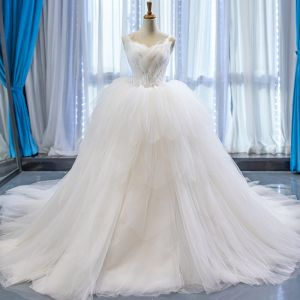 Stunning Ivory Wedding Dresses 2020 Ball Gown Spaghetti Straps Sleeveless Backless Beading Cathedral Train Ruffle