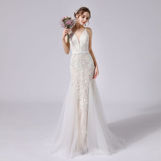 Charmig Champagne Bröllopsklänningar 2021 Trumpet / Sjöjungfru Spaghettiband Beading Spets Blomma Ärmlös Halterneck Svep Tåg Bröllop