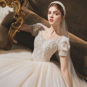 Vintage / Retro Audrey Hepburn Style Champagne Bridal Wedding Dresses 2020 Ball Gown See-through Scoop Neck Puffy Short Sleeve Backless Beading Glitter Tulle Chapel Train Ruffle