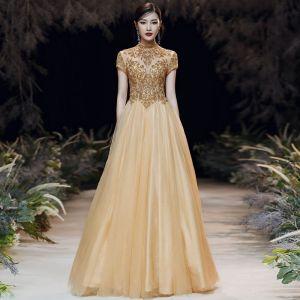Vintage Gold Durchsichtige Abendkleider 2020 A Linie Stehkragen Kurze Ärmel Perlenstickerei Lange Rüschen Rückenfreies Festliche Kleider