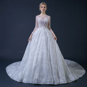 Illusion White See-through Wedding Dresses 2018 Ball Gown Scoop Neck Long Sleeve Glitter Tulle Appliques Lace Ruffle Cathedral Train