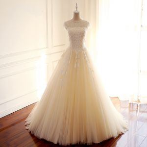 Vintage / Retro Champagne See-through Wedding Dresses 2018 A-Line / Princess Beading Scoop Neck Cap Sleeves Backless Appliques Lace Sweep Train Ruffle
