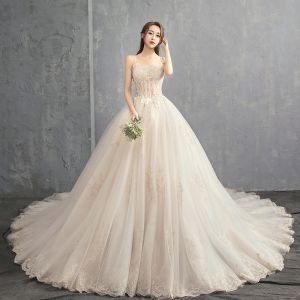 Elegant Champagne Wedding Dresses 2018 Ball Gown Spaghetti Straps Sleeveless Backless Appliques Lace Beading Ruffle Cathedral Train