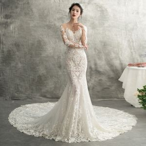 Vestido de novia corte sirena manga larga